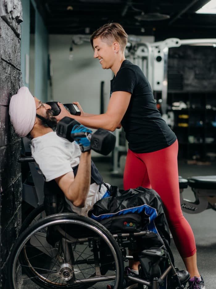 Megan helping a client with an exercise
