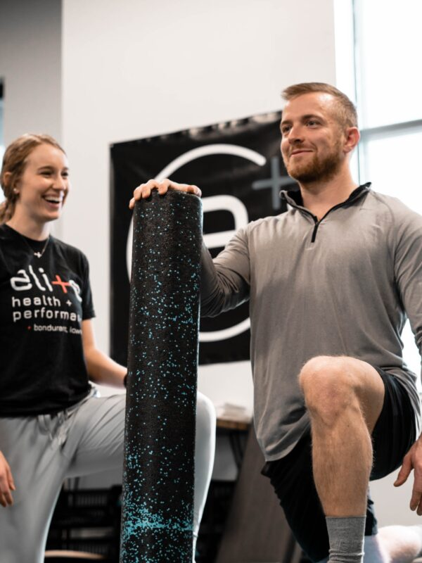 Personal trainer helping client with lunges in the gym - 4 reasons to fire your trainer